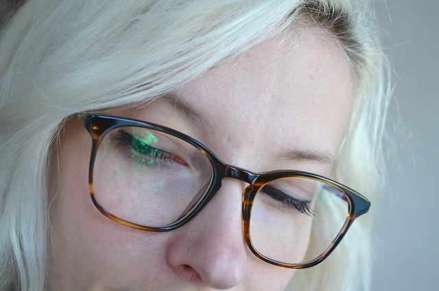 ace & tate AW15 glasses wilson in tiger wood closeup looking down