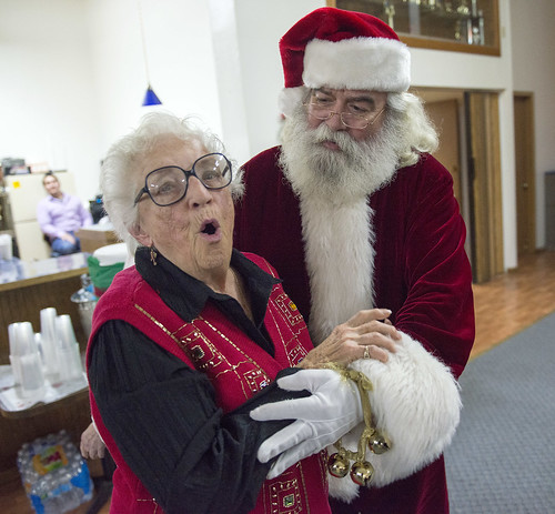 Rhoda Turinsky reacts with delight as Santa Claus makes an appearance at the Tyotkas Elder Center Christmas party in December.