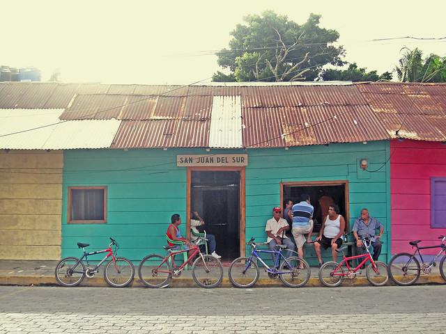 Locals sit, with their bikes, in San Juan Del Sur