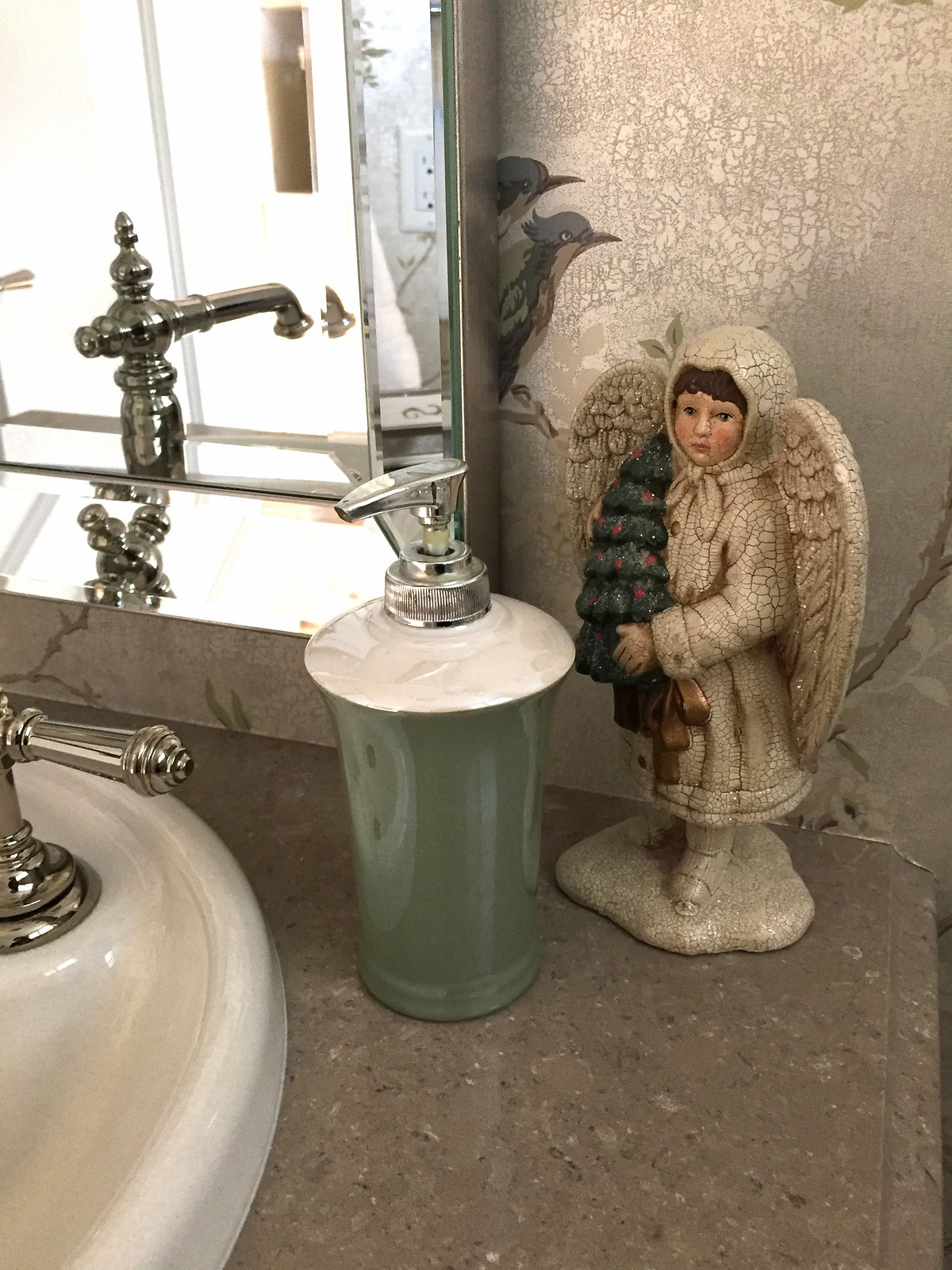 angel placed in elegant powder room for Christmas decor