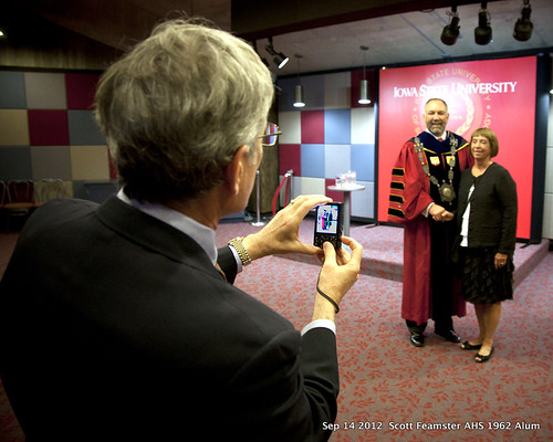 2012-09-14 Scott Feamster 1962 AHS Alum photographing  ISU President Steave Leath and Scotts spouse Carolyn