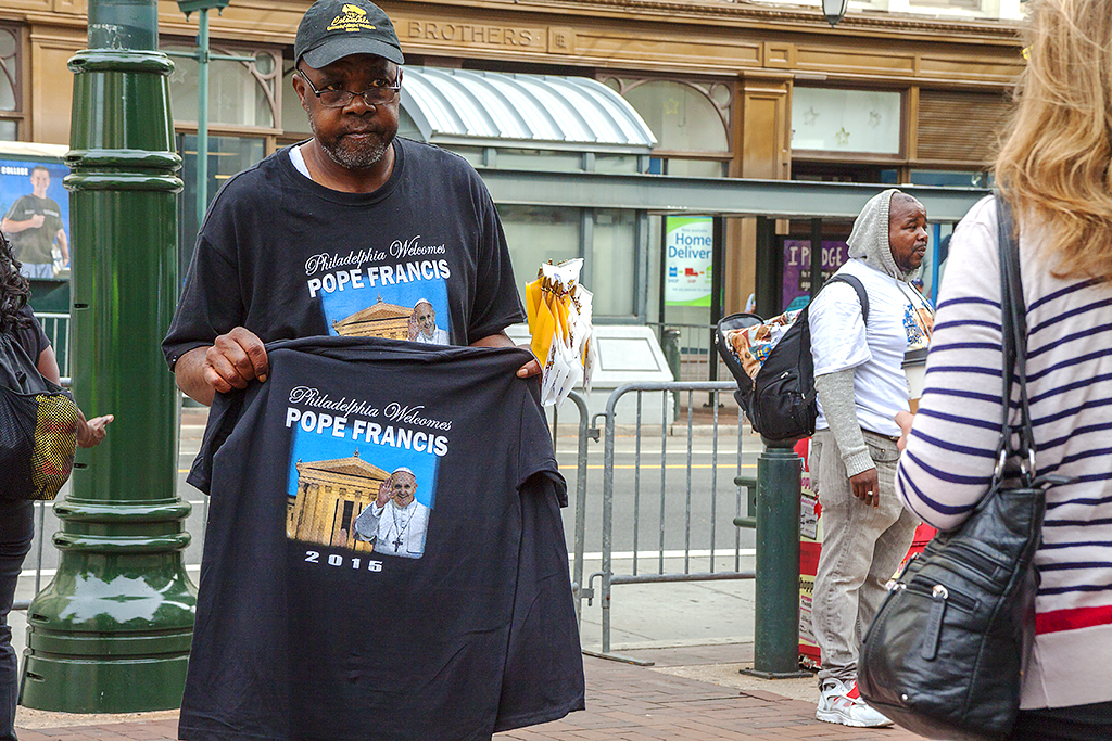 Man selling Pope Francis T-shirts at 8th and Market--Center City