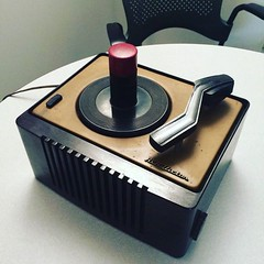 My latest piece of high-tech equipment, an antique 45 turntable. I've got a budget line item for vinyl production, and I need to start looking for Morse code repeaters next week. #whenyouworkatamuseum