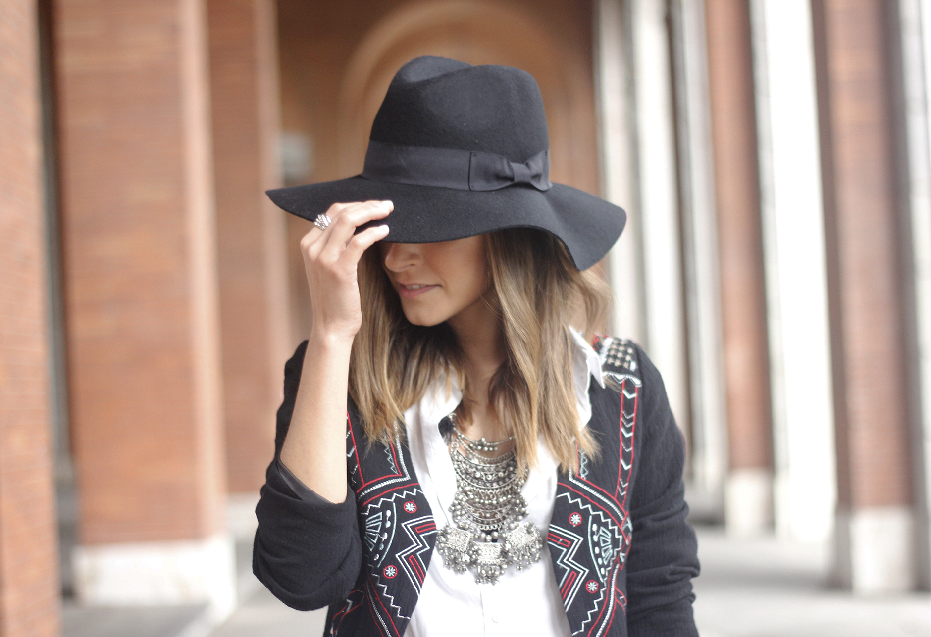 embroidered jacket black ripped jeans hat parfois red shoes outfit15