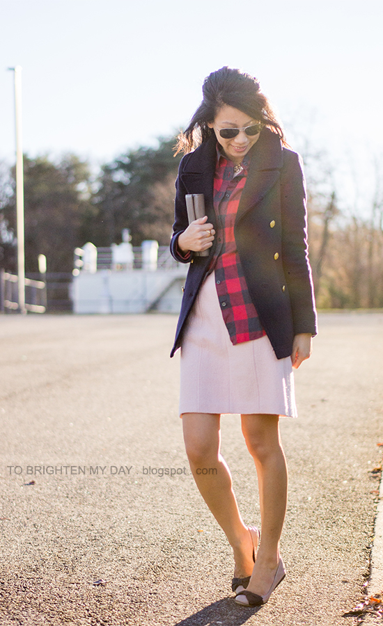 navy peacoat, layered necklaces, red buffalo check shirt, pink wool dress, taupe clutch, bow flats