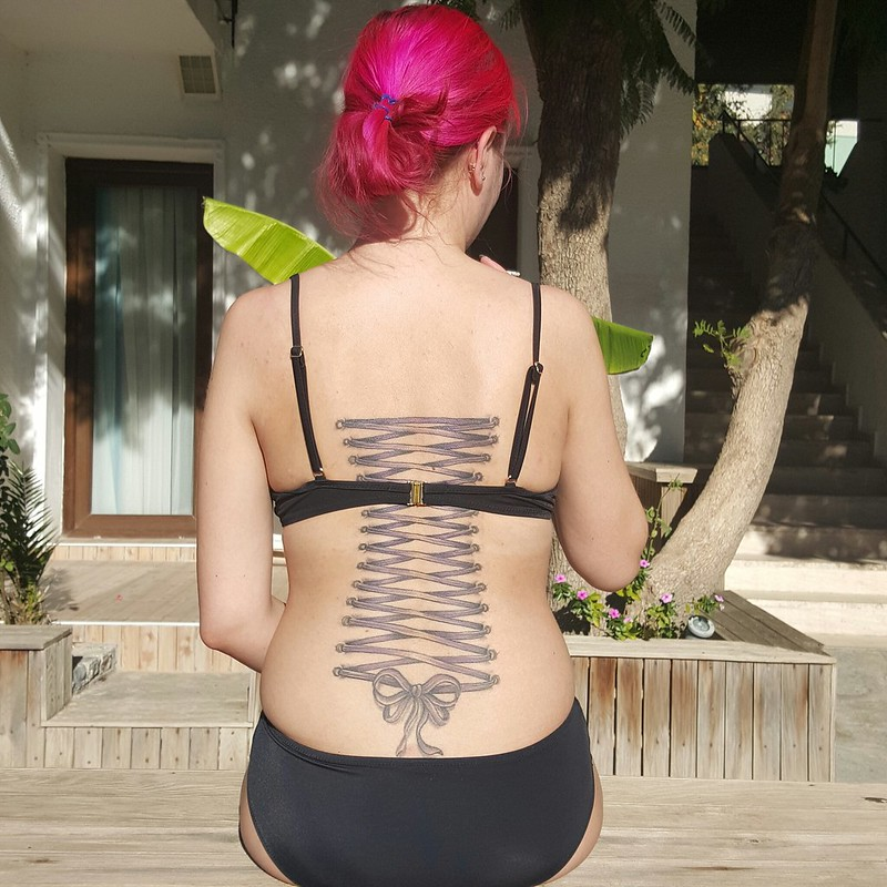 Corset lacing tattoo