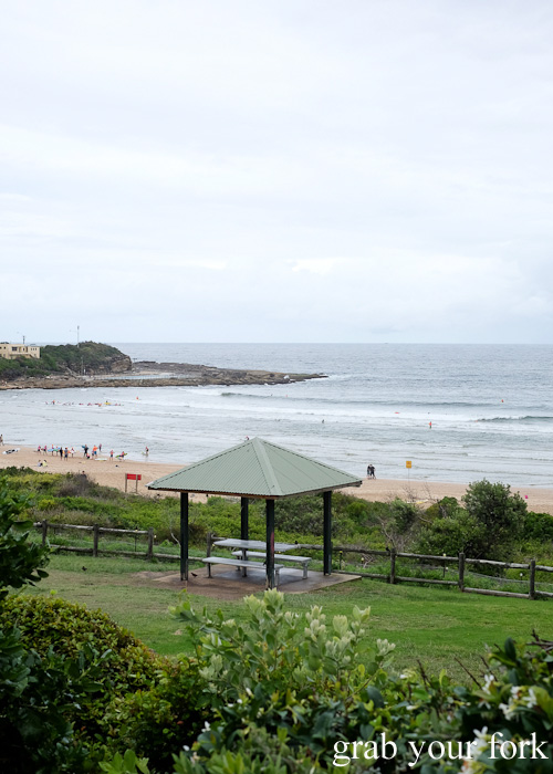 View of Freshwater Beach from the dining room at Pilu at Freshwater, Sydney