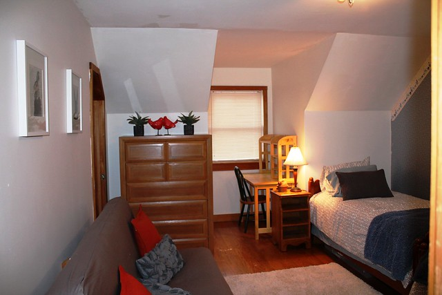 Second level guest bedroom with two twin beds and futon;