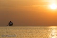 Sunset with cruise ship at the high seas               XOKA9584