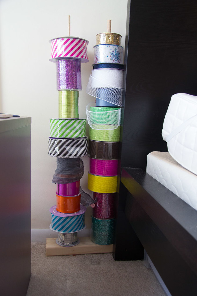 Ribbon storage behind bed