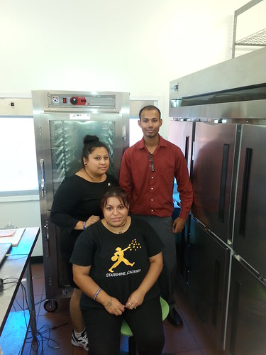 StarShine staff enjoying their warming well and refrigerator holding cabinet