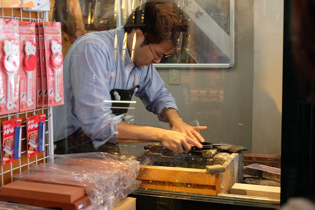 Knife sharpening on Kappabiashi Street