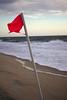 Beach Flag by Rich Renomeron