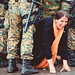 A woman cries as she crawls through a block of border police in the southern Macedonian town of Gevgelija, Sept. 10, 2015.