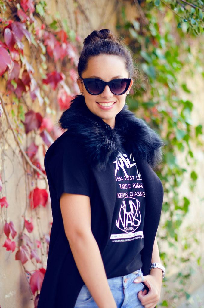 Look con chaleco negro para el otoño