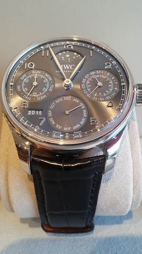 IWC Portugieser Perpetual Calendar, 7 day power reserve, moon phase display for northern and southern hemispheres.  18 karat white gold  $41,400.00
