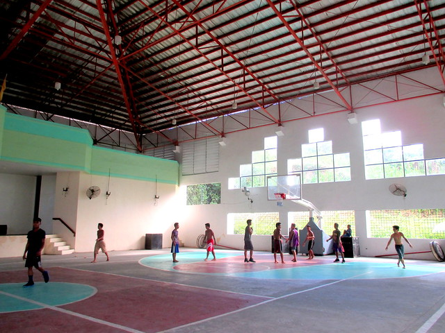 Basketball players in the newly-rehabilitated Santa Rita Civic Center