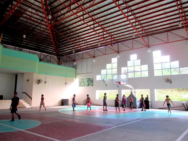 Basketball players in the newly-rehabilitated Santa Rita Civic Center