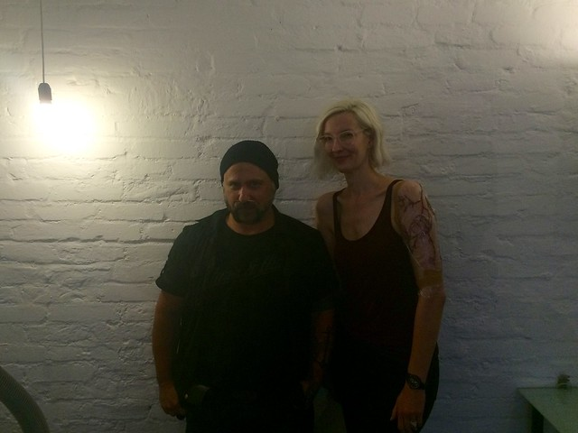 Brücius and me post-tattooing of floral arm piece at AKA Berlin