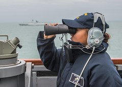 Seaman Carleen O. Binaoro stands watch while the Chinese guided-missile frigate Xuzhou (FFG 530) steams alongside USS Stethem (DDG 63) on Friday. (U.S. Navy/MC2 Kevin V. Cunningham)