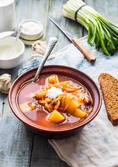 red borscht with sour cream, wild garlic, black br…