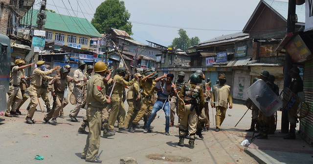 A youth being thranshed mercilessly by Indian Security forces in Maisuma area of Srinagar (By Raqib Hameed Naik)