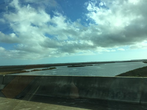bridge water car clouds traveling