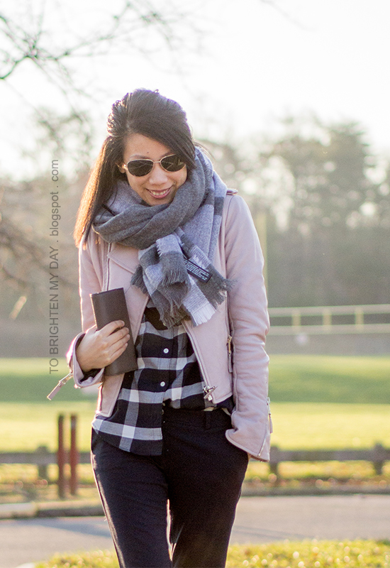 gray plaid blanket scarf, lilac leather jacket, navy plaid shirt, navy pants, taupe clutch