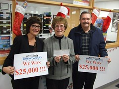 Early Bird Lottery Winners. Lori Mariuz (left) bought the ticket for her parents Robert and Marilyn Deschaine.