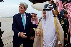 U.S. Secretary of State John Kerry walks with King Salman bin Abdulaziz of Saudi Arabia after he deplaned from his Boeing 747 following his arrival at Andrews Air Force Base in Camp Springs, Maryland, on September 3, 2015, to visit President Barack Obama.  [State Department photo/ Public Domain]