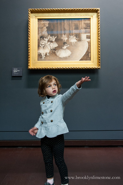 Aggie posing like a ballerina in the painting behind her at the Musee d'Orsay