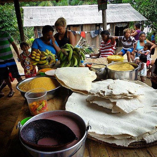 Breakfast of Champions. The kitchen in Paricatuba where I grew up as a kid close to the tribal Indians of Amazonas, Brazil. Note the huge farina cakes called beijou which is manioc root flour toasted over large steel plate skillets. Fruits abound here.  #