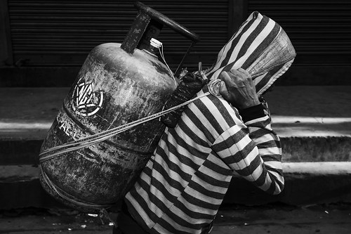 Man carrying gas tank