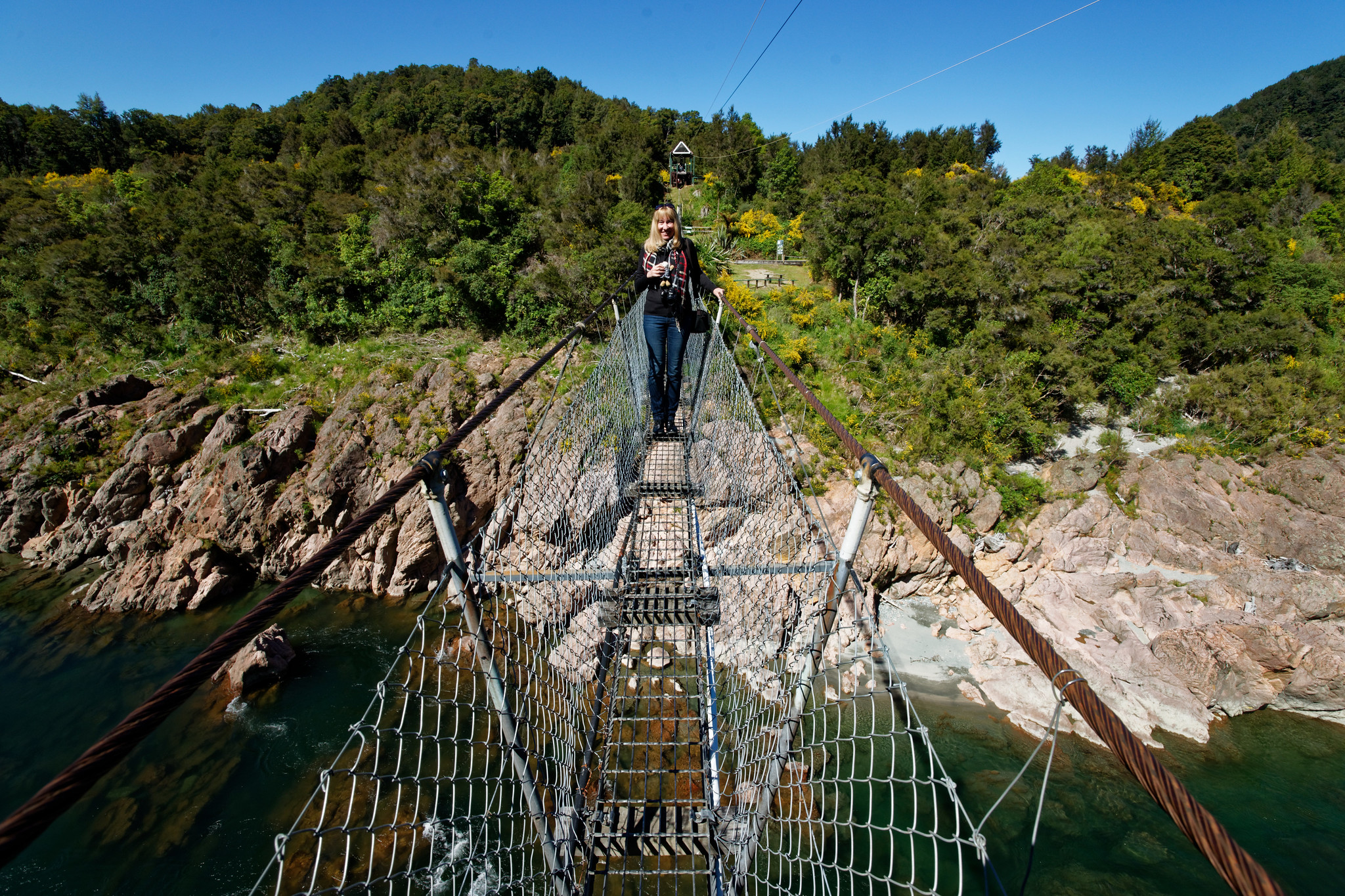 Cynthia Crosses The Buller Gorge Swingbridge