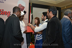 TOA Team honoring H.E Sirajudding Hamid Yousif with a present copy