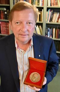 Tom Uram with Pope medal