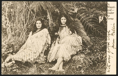 Postcard shows a photograph of two young Maori wom...