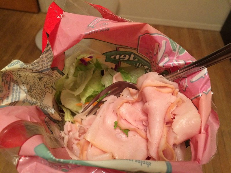 Sad salad with sliced turkey.