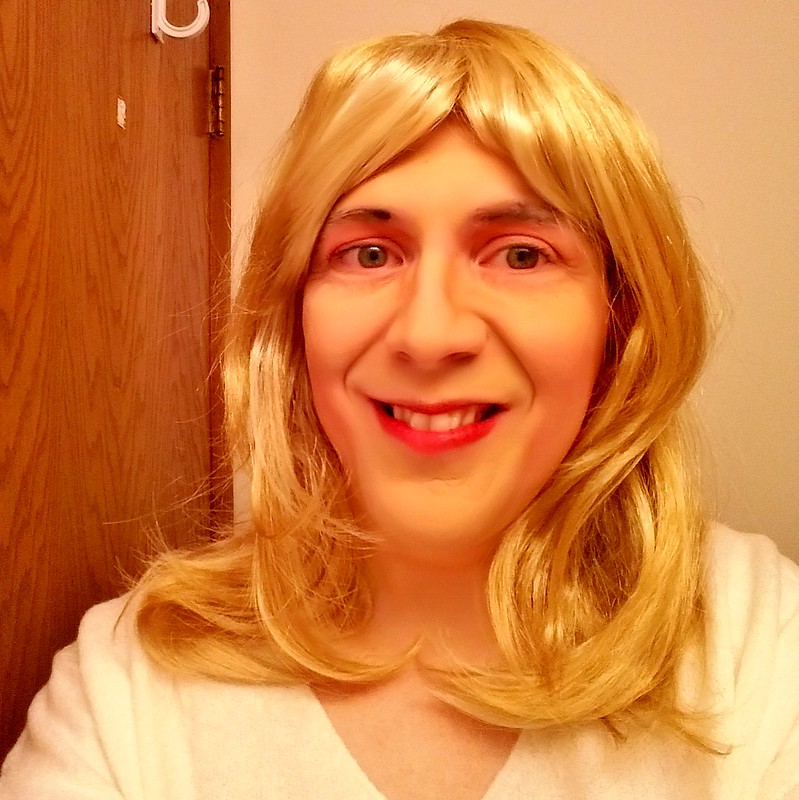 Feathery blonde hair selfie