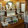 Revamped jewelry nook, stacked with salvaged dresser drawers, crates and wooden boxes. Necklaces hang from hooks inside, earrings dangle from strips of eyelet trim. #retaildisplay #jewelrydisplay #trashtotreasure #trashpicker