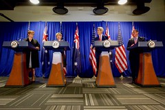 U.S. Secretary of State John Kerry listens as his Australian counterpart, Foreign Minister Julie Bishop, speaks at the Revere Hotel in Boston, Massachusetts, on October 13, 2015, during a four-way news conference with U.S. Defense Secretary Ash Carter and Australian Defense Minister Marise Payne following their annual AUSMIN diplomatic and defense meetings. [State Department photo/ Public Domain]