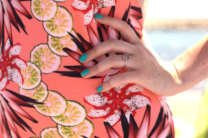fruit print bathing suit, aqua manicure