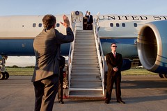 U.S. Ambassador to Haiti Peter Mulrean waves goodbye to U.S. Secretary of State John Kerry as be boards his plane at  Port-au-Prince International Airport to depart Haiti, on October 6, 2015. [State Department photo/ Public Domain]