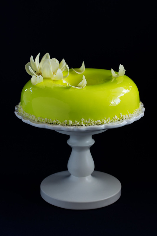 Pineapple mousse cake covered with a mirror coating.