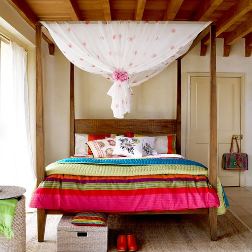 poster bed draped in florals