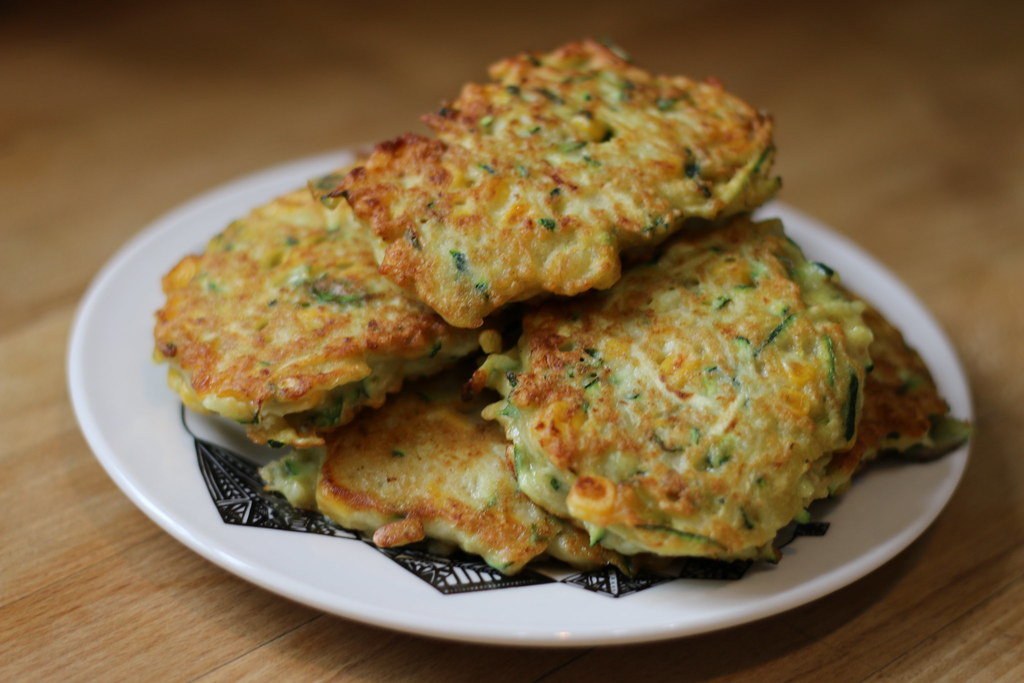 Pile of courgette, sweetcorn & chickpea fritters on plate
