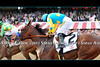 American Pharoah and Victor Espinoza at the wire, finishing second in the Travers