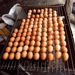 BBQ eggs at a roadside vendor in Koh Samui, Thailand. They cost 5 baht each.