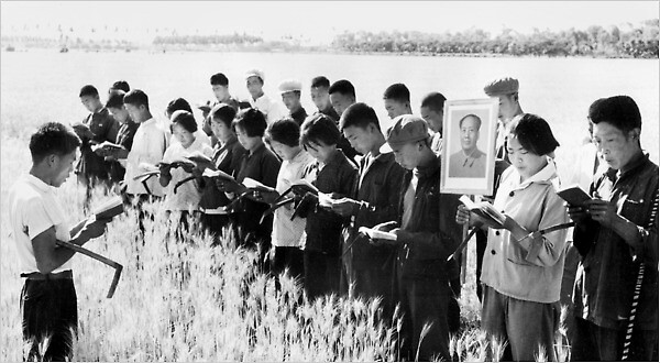 "Peasants recite Mao's ""Little Red Book"" before toiling in the fields near Beijing"