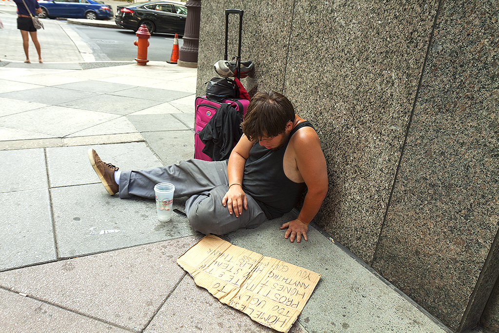 Man with small suitcase begging at Broad and Chesnut on 9-5-15--Center City
